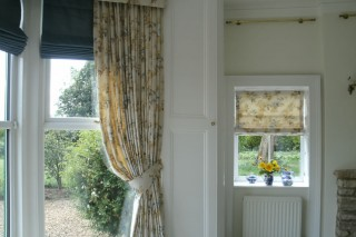Hard Pelmet Curtains and Roman Blinds, in Bay Window. Oakham, Rutland, Leicestershire.